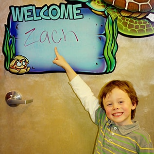Smile Surfers in Richland welcoming Zach to the dental family