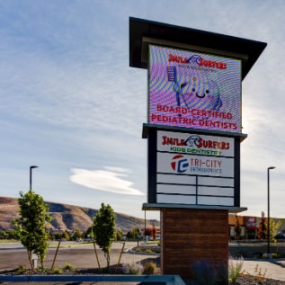 Signage advertising Smile Surfers Richland Office as pediatric dentists in Richland, Washington